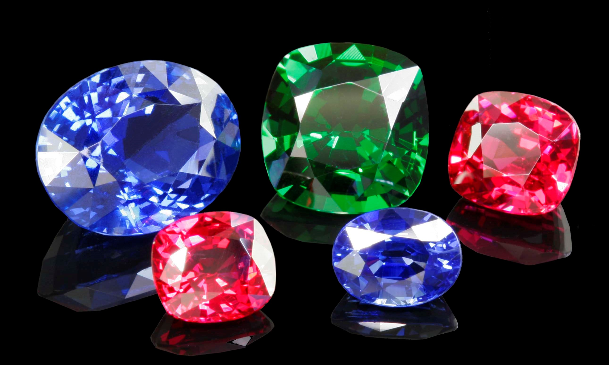 de inventory london tumbled s gemstone a sapphire exchange blogs diamond from gemstones purple coloured emerald